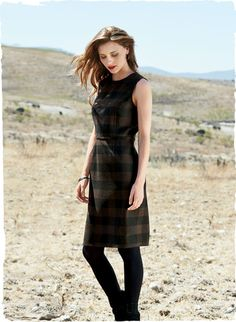 The consummate autumn dress, our sleeveless sheath is tailored in a muted buffalo plaid from Italy. The body-skimming silhouette is styled with a high neck, back zipper and a defined waist seam. Wool (70%), polyester (28%) and lyocell (2%); lined.