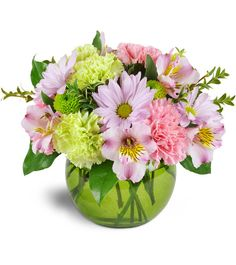 Put some spring in their step with our charmingly fun Spring Forward Bouquet™! For Easter, Mother's Day, and more, these pastel hues are a perfect pick-me-up and will convey your love with cheer!  Pastel pink and green carnations, daisies, alstroemeria, and more are arranged in a lively green glass bubble bowl.