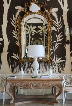 Lyford Cay - Opulence at its best - white & black wallpaper, gilded gold mirror, and a white pineapple lamp Interior Flat, Home Interior, Interior And Exterior, Chinoiserie Elegante, Pineapple Lamp, Brown Walls, Deco Table, Of Wallpaper, Chinoiserie Wallpaper