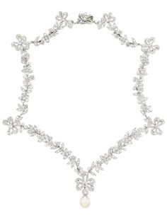 A Belle Epoque Platinum, Diamond and Natural Pearl Necklace, Circa 1910. The delicate necklace of bow and garland motif set throughout with old European, old-mine and rose-cut diamonds, supporting one drop-shaped pearl. #BelleÉpoque #necklace