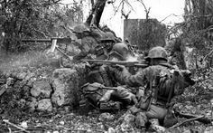Firing line of 1st Division US Marines engages the Japanese defenses in the broken ground southeast of the Machinato airfield - Battle of Okinawa, May 1945. (From the Division of Public Information, USMC)