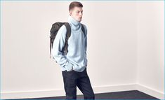 Dressing for fall, Bastian Thiery sports an oversized turtleneck sweater from Ami with Jean Shop denim jeans and a Missoni utility backpack from Matches Fashion.