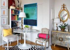 I like the contrast between the tulip table and the traditional chairs. I also love the colors and the art.