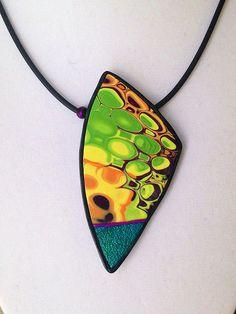 Polymer clay mokume gane pendant by beadunsupervised.
