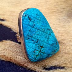 Large Vintage Stephen Dweck Carved Turquoise Ring Stunning Simple Floral Pattern Repeated on Large 30mm X 40mm X 8mm Oblong Turquoise Cabochon with Copper Colored Matrix. Bezel set in Solid Sterling/ Brass Colored Decorative Ring, Gorgeous Pattern in metal underneath stone, Braided 6mm Wide X 2.5mm thick Band, Marked Stephen Dweck 925 Stephen Dweck Jewelry Rings
