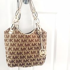 """🌺Final Price🌺 Michael Michael Kors Medium Lilly Basically NEW. Only worn 2x by my sissy.   Brand - Michael Michael Kors Bag Depth - 4"""" Style - Totes & Shoppers Bag Length - 13"""" Material - PVC Strap Drop - 9"""" Color - light brown  Size - Medium Bag Height - 11"""" MICHAEL Michael Kors Bags"""