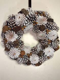 18 pine cone wreath in white with natural colored pine cones and acorns. Beautiful winter decor that will last indefinitely.