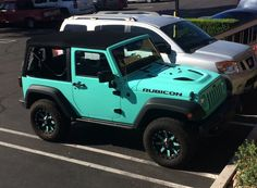 Pictures and description of a 2014 Jeep Rubicon Tiffany Blue. Teraflex Leveling Kit, Toyo Tires, Fuel Offroad Wheels, Tiffany Blue Wrap.