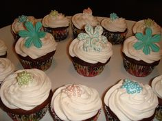 Chocolate cupcakes with vanilla whipped frosting topped with candied pearls