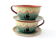 Love the colors on these vintage tin tea cups!! I had a tea set of Little Red Riding Hood that I used to serve tea to my dollies.....miss that set!!