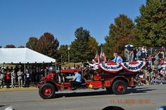 Mayor Tommy Battles riding on a Fire Truck in the Veterans Day Parade in Huntsville, Al
