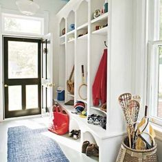 This mudroom off the back door serves as the home's primary entrance for a family of four. A built-in with graceful arches and curves makes the area dressy enough for guests, too.