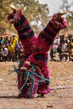 Mask Festival in Dédougou, Burkina Faso: At the end of dry season many tribes of Burkina Faso ask the masks to protect the villages and to call for rain.