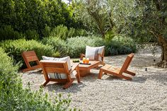 CR Landscape idea for northern tip of property. Gravel, sparse green: a destination outdoor room. .A selection of the brand's outdoor furniture is grouped in the garden.