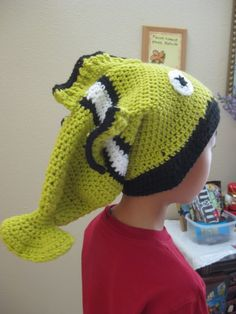 Green crochet fish hat... might have to make that in orange for my boy...