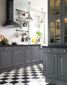 #kitchen, #tile, #kitchen-cabinets, #gray, #black-and-white, #floor    View entire slideshow: 15 Stunning Gray Kitchens on http://www.stylemepretty.com/collection/277/