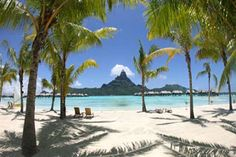 Bora Bora, in the South Pacific, is the most beautiful island in the world. Lush tropical valleys meet  perfect white-sand beaches and give way to emerald waters where colored fish animate the coral gardens. Illuminated lagoons and palm-covered motu circle the island. Luxury resorts and spas dot the island with overwater bungalows, thatchedroof villas, and fabled ambience.