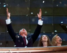 President Bill Clinton, his wife Hillary and daughter Chelsea celebrate the…