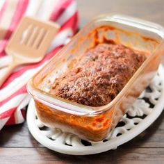 A recipe for meatloaf, a classic ground beef dish made with onions, green peppers, celery and seasonings. It is baked with a sauce which keeps it moist.