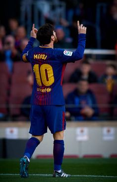 Lionel Messi of Barcelona celebrates after scoring the second goal during the La Liga match between Barcelona and Athletic Club at Camp Nou on March...