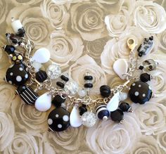 Black and White Braceket .. made with beautiful black,, black and white and white glass beads .. For Sale