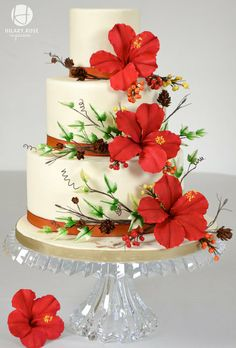 Hibiscus Winter Wedding ~ showy red Hibiscus, larch cones, winter berries and variegated ivy.