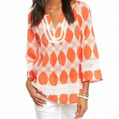 Create a chic, boho-inspired look with this crown and ivy orange print peasant top. Featuring a flattering split neckline and crochet details, this printed style is sure to make a statement when paired with faded jeans and fringe booties.