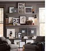This is a great gallery wall using small shelves and a combination of hanging art, leaning art and decorative objects.