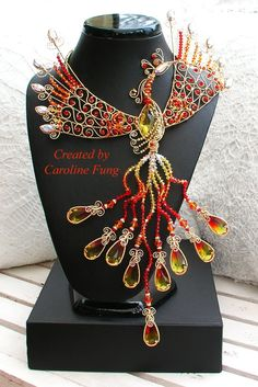 Wow that's fabulous.. On a simple but elegant red, black, yellow, or orange dress..a show stopper