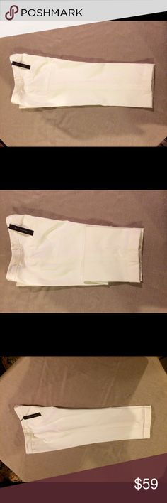 """⛱Elie Tahari White Crop Pants⛱ ⛵️The Sloane Pant by Elie Tahari Excellent Condition!                             There is a lot of body to this fabric.   Has a really flattering fit.                                Belt Loops, Turned Up Cuffs,                 2 Back Pockets                                      56% cotton, 37% poly, 7% spandex         Front zip and hook                           16.5"""" waist, 9"""" front rise, 13.5"""" back rise,22"""" inseam…"""