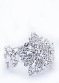 Glam up your florals with the stunning, glittery Arawa cuff for your wrist. Twinkle Twinkle Tiaras designs are available from Bella Brilla - http://www.bellabrilla.com/designers/twinkle-twinkle-tiaras.html