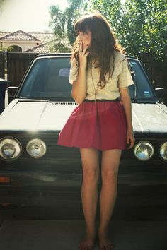 her outfit is cute AND she has the same car as me!!
