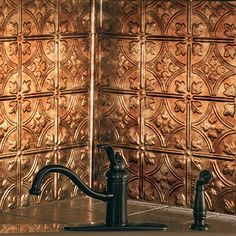 Love the backsplash!!  Get the look of embossed vintage tin for backsplashes, ceilings and walls with thermoplastic Fasade Decorative Panels ($18). Theyre water-, impact-, and corrosion- resistant and more affordably priced than metal panels. Available in 16 finishes and 7 embossed styles. Surely I can hang this myself?