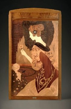 Joan Busquets i Jané (1874-1949) - Marquetry Panel of a Lady with a Flower. Walnut with Marquetry Inlays. Barcelona, Spain. Circa 1904. 120cm x 67cm x 3.5cm.