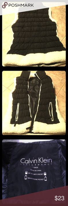 🎉LIKE NEW! CALVIN KLEIN FURRY TRIMMED VEST Beautiful Calvin Klein Performance black & white vest. Size L. Has zip security pocket & smartphone pocket, 2 working side zippers with logo & zipper to open & close with logo. Body & Fill: 100% polyester, Lining: 100% nylon. Very soft & comfortable. Smoke/pet free. Calvin Klein Jackets & Coats Vests