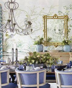 looks like a gorgeous dining room in Palm Beach and I love the blueish purple color of the chairs and table decor
