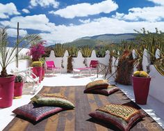 On this home's main rooftop terrace, the floor cushions are upholstered in Kuba cloth and antique silk saris.