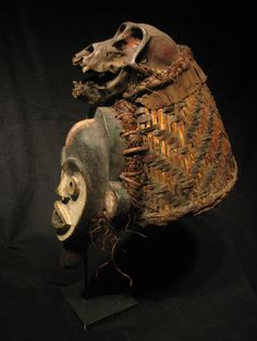 A Cameroun Tikar mask with a monkey skull at the top