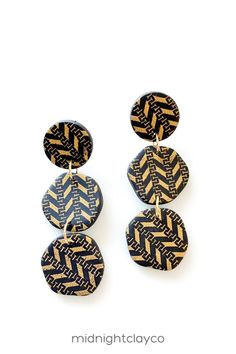 Black with gold print polymer clay earrings. Tiered organic shaped dangle earrings. Unique boho style earrings make the perfect accessory for a summer or fall work outfit. Give as a unique birthday gift for sister in law, niece, or female coworker. Makes a great fall birthday gift! Shop these trendy handmade earrings for women in my etsy shop! Aztec Earrings, Triangle Earrings, Women's Earrings, Black Earrings, Birthday Gifts For Sister, Unique Birthday Gifts, Earrings Handmade, Handmade Jewelry, How To Clean Earrings
