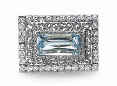 A gold and platinum-mounted aquamarine and diamond brooch
