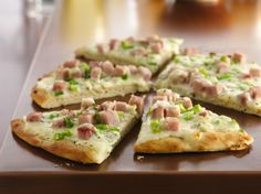 Hot from the oven in an hour, this homemade pizza beats delivery any day! Alfredo sauce, ham and Gorgonzola are a tasty alternative to typical pizza fare.
