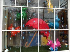 Window Display - It's Raining Rodys! Giant umbrella, paper raindrops and assorted Rody bouncing toys. April 2012