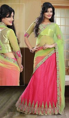 Standout in the crowd dressed in this pink color embroidered net lehenga choli dress. This pretty dress is showing some unbelievable embroidery done with brocade patch, lace, patch and resham work. Upon request we can make round front/back neck and short 6 inches sleeves regular lehenga blouse also. #IndianTrendyLookLehengaCholi