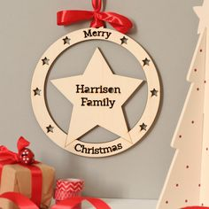 A beautiful personalised wooden laser cut Christmas wreath - a perfect family gift! Featuring a very festive star shape to decorate the house throughout Decembe