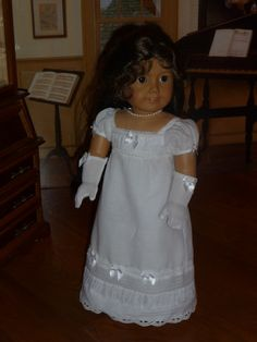 This is a white Regency dress for the American Girl dolls, with pintucks and ruching.  Drafted and sewn by me -- Sewbig!