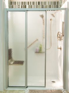 Vitalize from Premier Care-  triple panel doors with one fixed panel and two sliding panels open to provide full barrier-free access across 2/3 of the width of the shower. The door frames are trackless at the bottom providing a smooth and safe ultra-low threshold shower entry. A wood fold-down seat lets you sit both safely and comfortably.