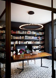 Love the dark walls and light flooring, and that light fixture is superb! Tour a Stunningly Chic London Townhouse via @mydomaine