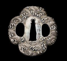 A tsuba, a decorative sword guard on the hilt of Japanese samurai swords.