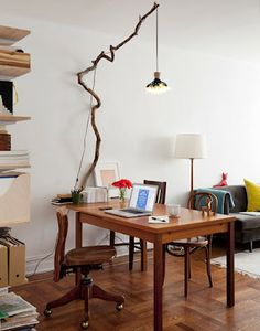 """Pendant Lamp hanging from a large branch nailed to the wall. """"And branches are something I drag home all the time."""" Kimi Weart and Paul Galloway on Design Sponge. Branch Decor, Decor, Interior Design, Furniture, Design Sponge, Interior, Home Diy, Branch Chandelier, Home Decor"""