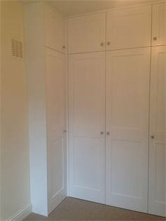 Full height alcove corner wardrobe with panelled doors, satin finish